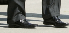 McCains actual feet. In his $520 shoes.